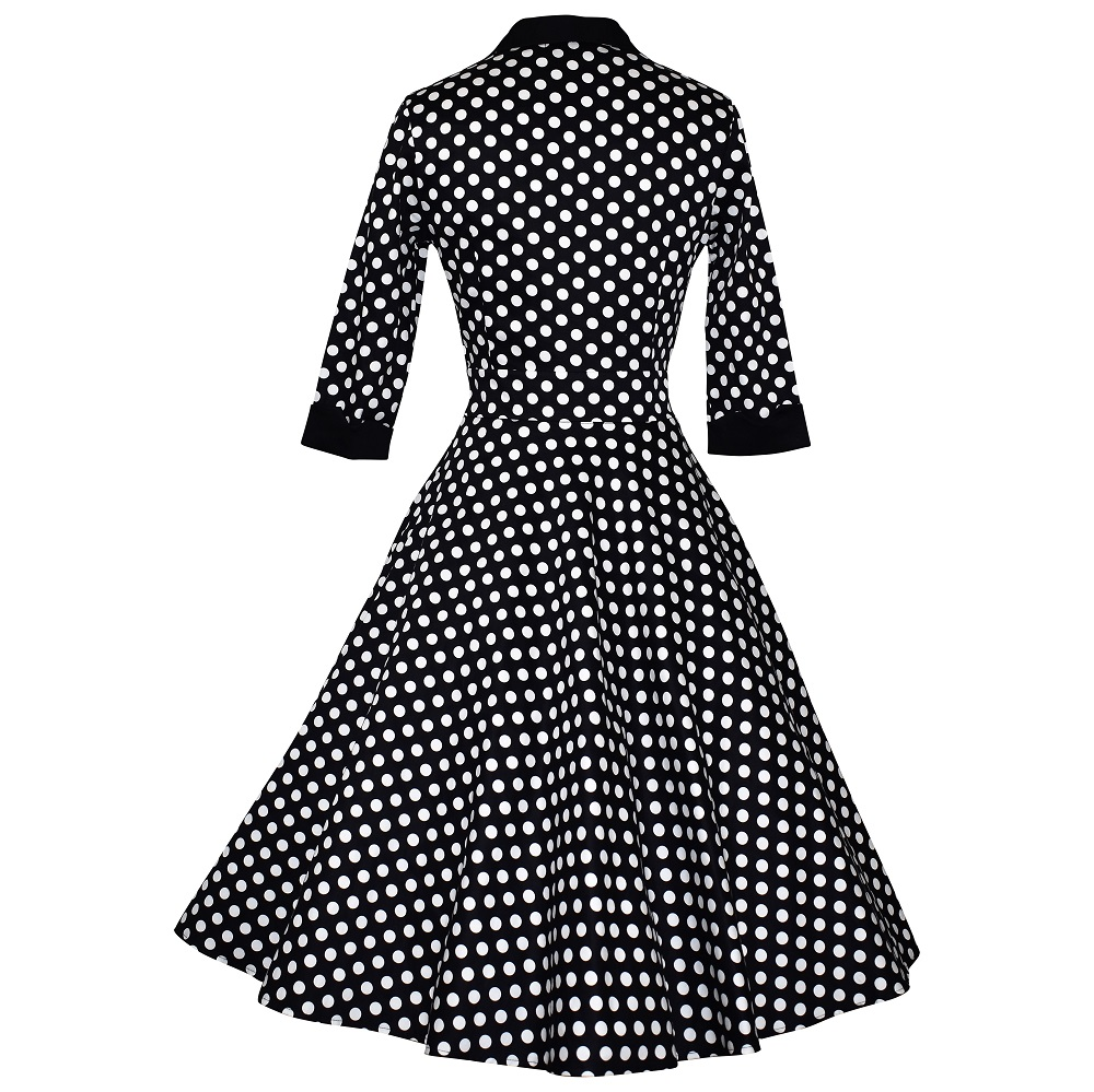 Vintage style polka dot shirtdress with swing skirt and 3/4 sleeves back view