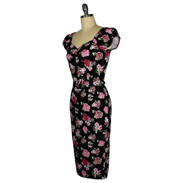 Siren Clothing 50's vintage-inspired wiggle dress with elasticated sleeves in pink posy on black cotton spandex fabric, side view