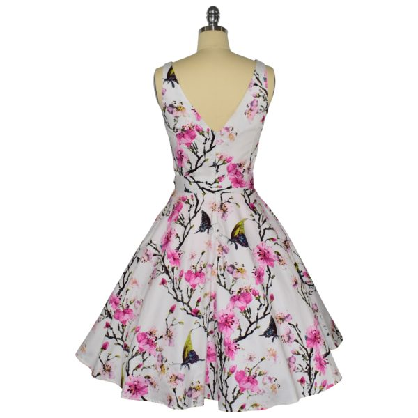 Siren Clothing 50's vintage-inspired high necked, sleeveless swing dress in butterflies and blossom cotton spandex fabric, back view