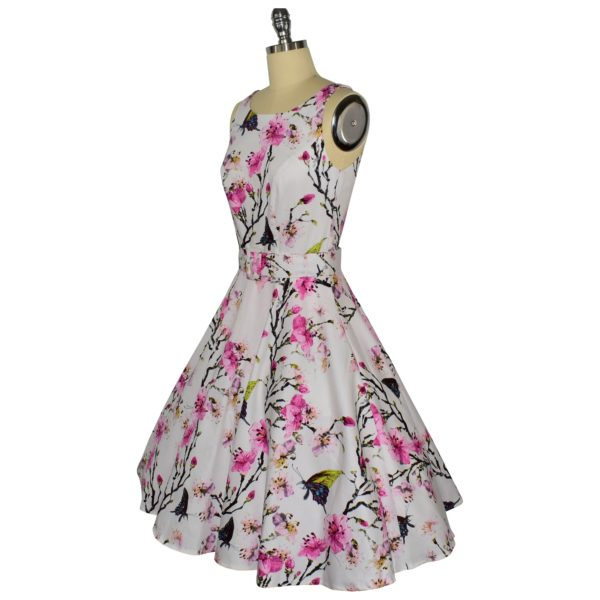 Siren Clothing 50's vintage-inspired high necked, sleeveless swing dress in butterflies and blossom cotton spandex fabric, side view