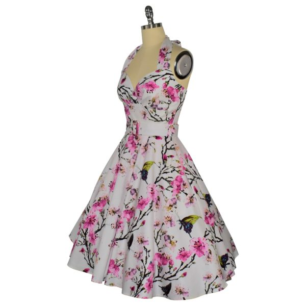 Siren Clothing 50's vintage-inspired halter neck swing dress in butterflies and blossom cotton spandex fabric, side view