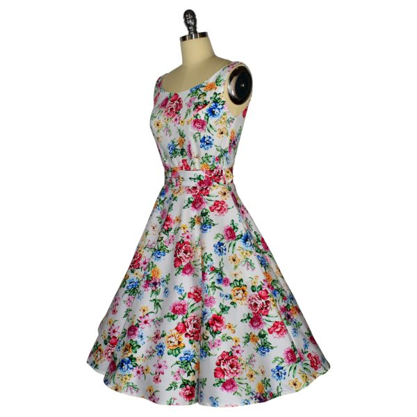 Siren Clothing 50's vintage-inspired scoop neck swing dress in white floral print fabric, side view