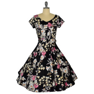 Siren Clothing 50's vintage-inspired swing dress with short sleeves in black and pink floral fabric.