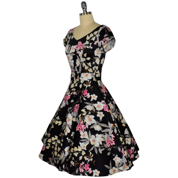Siren Clothing 50's vintage-inspired swing dress with short sleeves in black and pink floral fabric, side view
