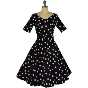 Siren Clothing 50's vintage-inspired swing dress with sleeves in black and white polka dot fabric
