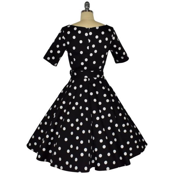 Siren Clothing 50's vintage-inspired swing dress with sleeves in black and white polka dot fabric, back view